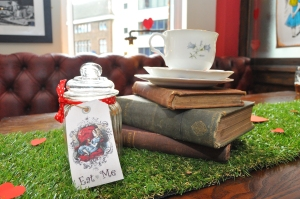 Table centrpiece with vintage books for an alice in wonderland party
