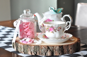 Alice in Wonderland inspired table centrepiece with vintage tea set and pink shrimps