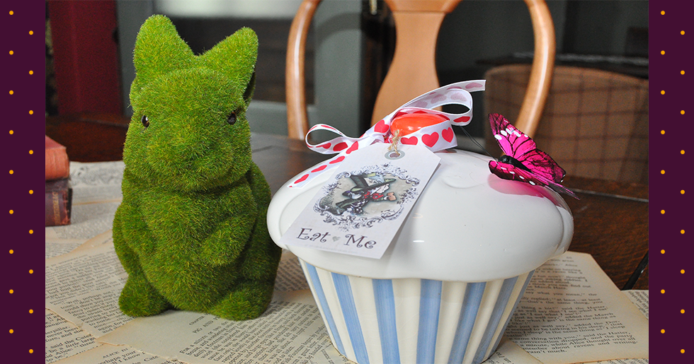 alice in wonderland birthday party with grass rabbit and oversized sweet jar